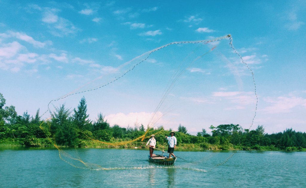 Fishermen casting their net
