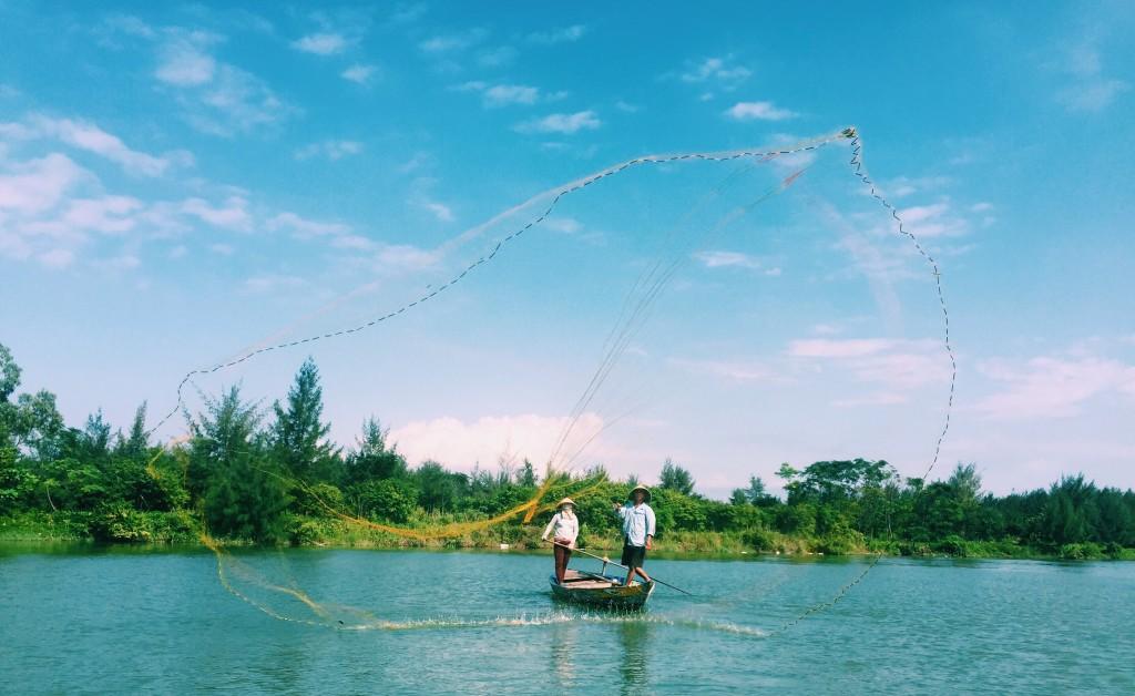 Fishermen casting their net