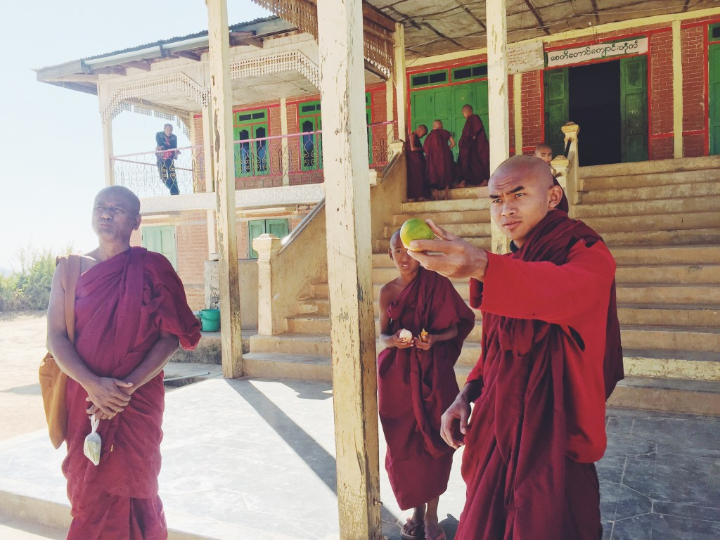 Monks at the monastery offering us fruit