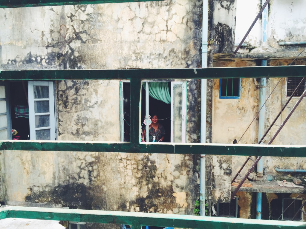 Our neighbor across the alley who smiled, waved and welcomed us to Myanmar as soon as we arrived in our rooms