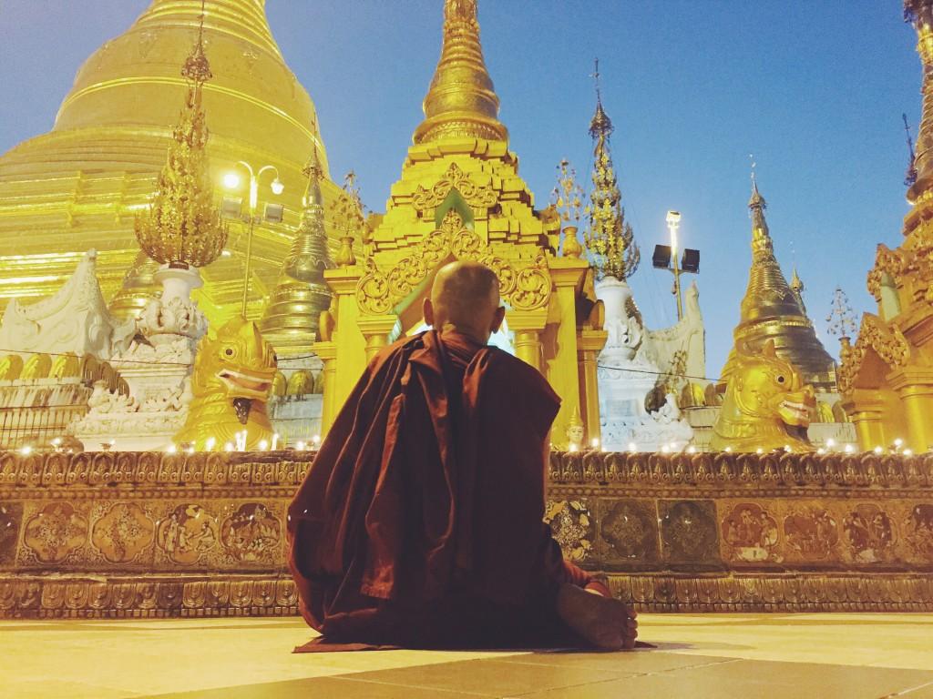 Monk praying at the pagoda